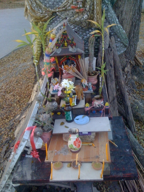 A spirit house set up at the base of a tree. Sunday, 6:30 p.m., February  9, 2014.