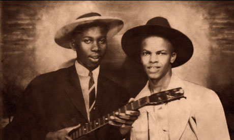 The man on the left has been identified as Robert Johnson, the legendary blues singer and guitarist.