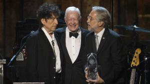 Dylan accepting his award, standing beside Jimmy Carter.